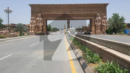 IMC ESTATE OFFERING 10 MARLA PRIME AND HOT LOCATION POSSESSION UTILITY PAID CORNER 25 SQ FT PAID ALL DUES CLEAR PLOT FOR SALE IN OVERSEAS A BLOCK BAHRIA TOWN LAHORE