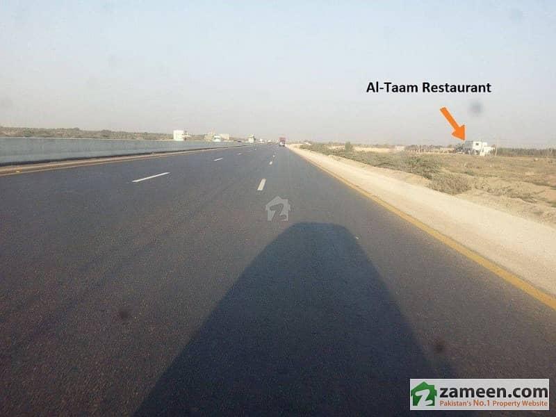 1000 yards Plots on installments Farm Houses Land possession on 50 percent payment Super Highway near DHA CITY Karachi