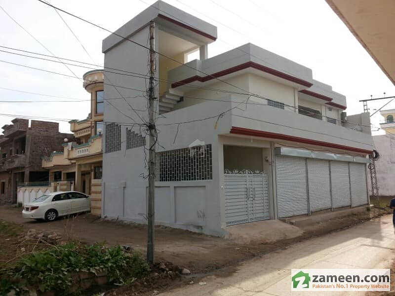 new house with 4 shops for sale