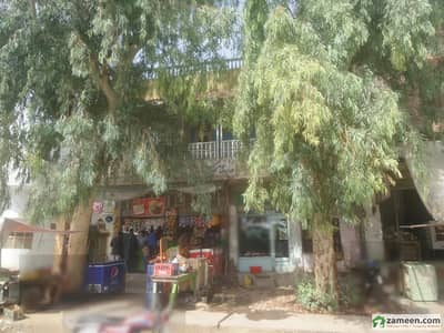 House With 4 Shops For Sale