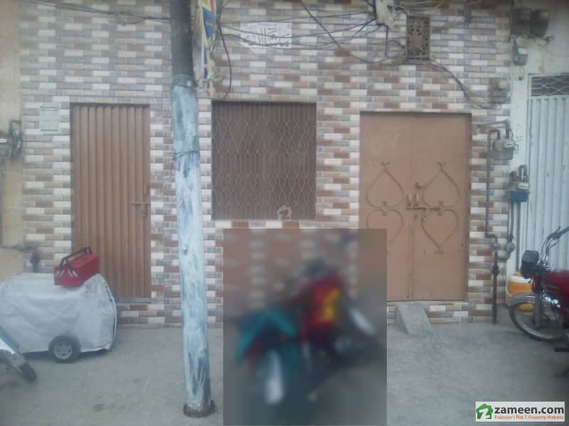 Double Storey Facing Canal Commercial House For Sale