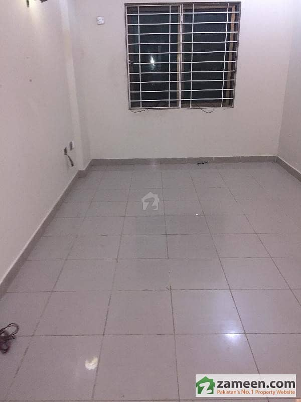 1020 Sq. Feet Apartment 1st Floor Tile Flooring West Open For Sale In Bukhari Commercial Area