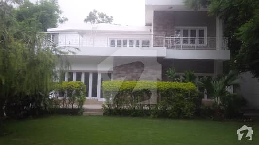 A very beautiful spacious house of the four beds with huge green lawn