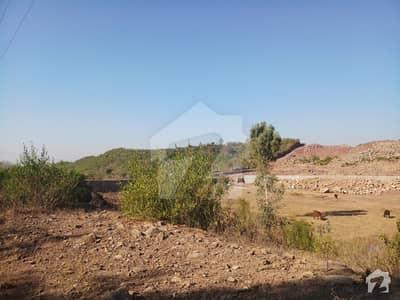 20 Kanal Land For Sale Boundary Wall On Main Jandala Road.