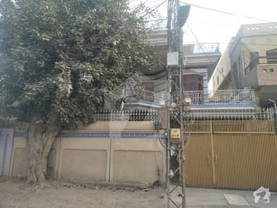 10 marla double storey diar wood work house at excellent main location