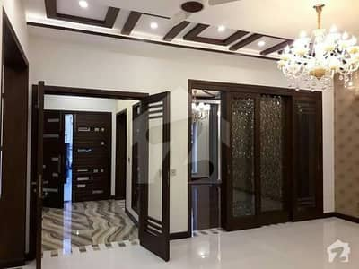10Marla BRAND NEW TILES FLOORS DOUBLE story house 6bedroom 2kitchen drawing room t. v. lunch 3car parking in tariq gardens Lahore