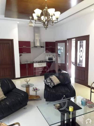Original pics One Bedroom full furnished for rent in DHA phase 5 TV launch and kitchen