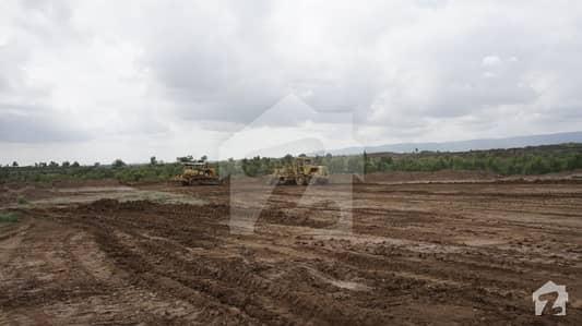 خائنال ھومز چکری روڈ راولپنڈی میں 2 کنال زرعی زمین 18 لاکھ میں برائے فروخت۔