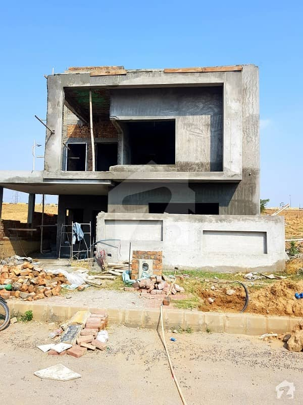 10 Marla house Available On easy 10 months installments. 70 % work done. 30 % downpayment.