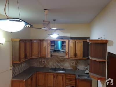100 Yards Bungalow 4 Beds Attached Bath Kitchen Lounge  Store Powder Room  1 Car Parking