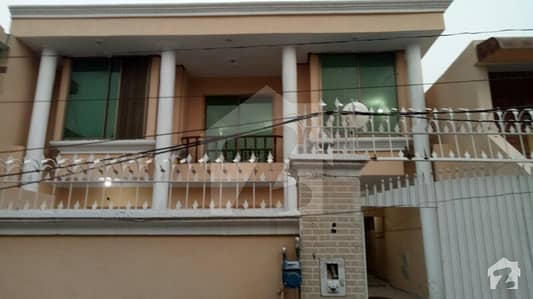 11 Marla double story house 4 rooms 4 bathrooms drawing room 2kitchens (A block old settalite town sargodha)