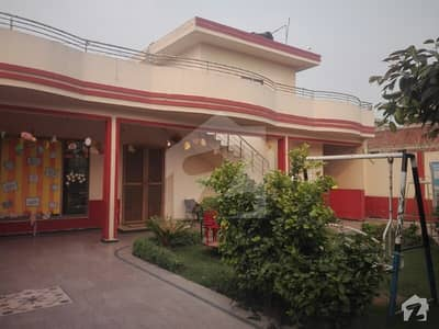 20 Marla Single Storey House For Sale In Amir Town Lahore