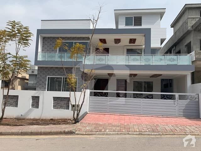 ideal location 1 kanal 7bedrooms triple storey with besement brand new house available for sale in bahria enclave Islamabad sector c