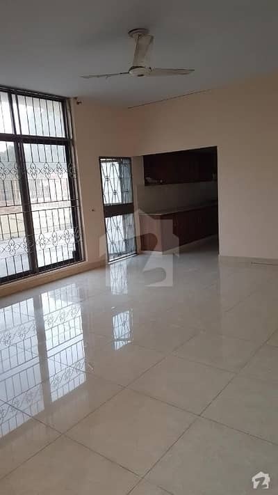 1 Kanal Upper Portion Lower Lock fully Tile 2 Bed Tv Launch Kitchen Store Car parking Lush Portion lawn