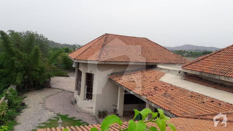 ناول فارمز ہاؤسنگ سکیم اسلام آباد میں 5 کمروں کا 27 کنال فارم ہاؤس 14 کروڑ میں برائے فروخت۔