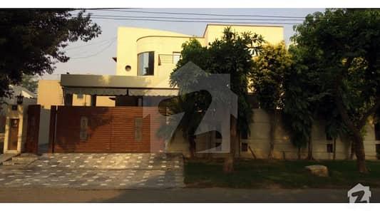 DHA Lahore Kanal Stylish Triple Unit Bungalow