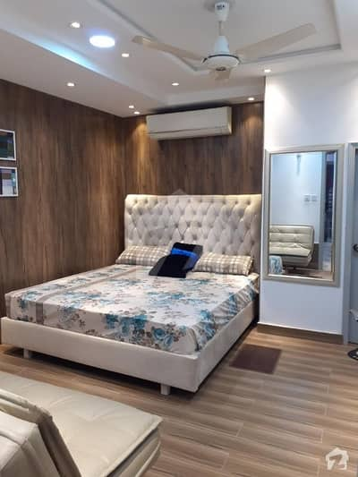 fully furnished brand new luxury flat for sale in Tariq plaza h3 block near emporium mall johar town lahore
