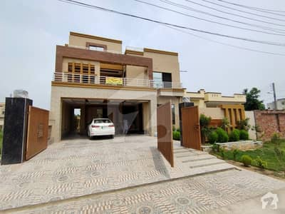 One Kanal Brand New Designer House With Decent Accommodation